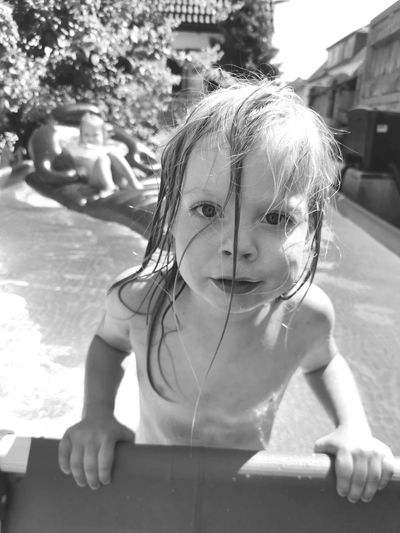 Portrait of a girl looking at swimming pool