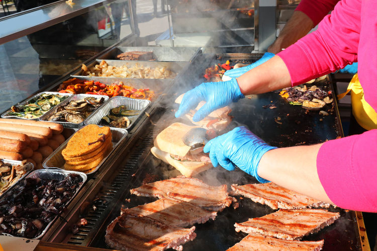 High angle view of people on barbecue grill at market
