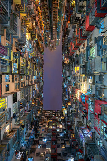 Aerial view of Yick Fat Building, Quarry Bay, Hong Kong. Residential area in old apartment. High-rise building, skyscraper with windows of architecture in urban city at night. Hong Kong City Cityscape Architecture Buildings Skyscrapers Windows Building Exterior Built Structure Building Illuminated Night Residential District Skyscraper No People Window Office Building Exterior Apartment Modern Outdoors Sky Full Frame Nature Directly Below Yick Fat Building