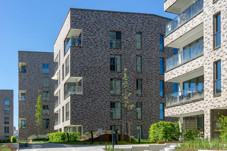 modern building for living in the city of rostock Building Exterior Built Structure Architecture Building Residential District Window City Day Clear Sky Nature Sky No People Sunlight Low Angle View Plant Outdoors Blue Modern In A Row House Apartment