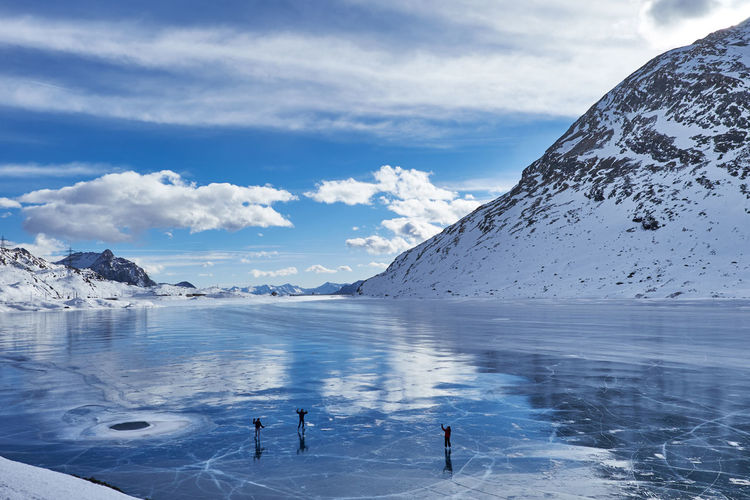 Cold Temperature Ice Landscape Frozen Cloud - Sky Outdoors Glacier People Ice Skating Bernina Swiss Alps Swiss Mountains Alps Mountains Winter Lake Iced Lake Swiss Eyem Galery Beauty In Nature Mountains Reflections Reflected Glory
