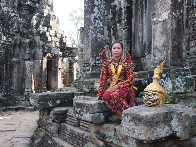 Cambodian woman posing for tourist in Apsara costume at Bayon temple in Angkor. Angkor Angkor Thom Angkor Wat Apsara Architecture ASIA Asian  Asian Culture Bayon Building Cambodia Cambodian Costume Female Girl Historic History Khmer Southeast Asia Temple Tourism Travel Woman