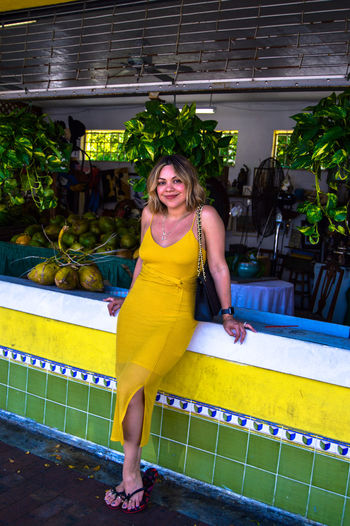 Mellow Yellow in Little Havana Peoplephotography Frutería Fashion Photography Streetphotography Street Fashion Vacation Dress Yellow Yellow Dress Fruit Shop Natural Beauty Natural Bright Colors The Fashion Photographer - 2018 EyeEm Awards Portrait Full Length Smiling Women Looking At Camera Beautiful Woman Happiness Beauty Yellow Posing Sundress Urban Fashion Jungle Summer In The City
