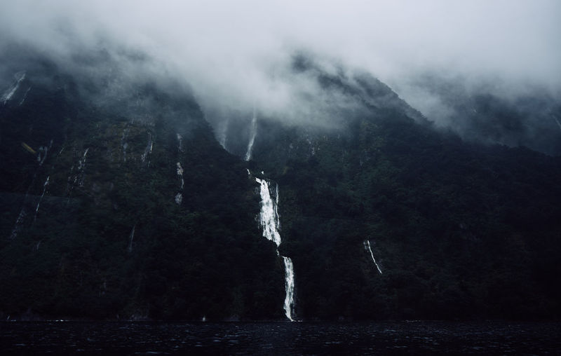 Low Angle View Of Waterfalls In Foggy Weather At Te Anau