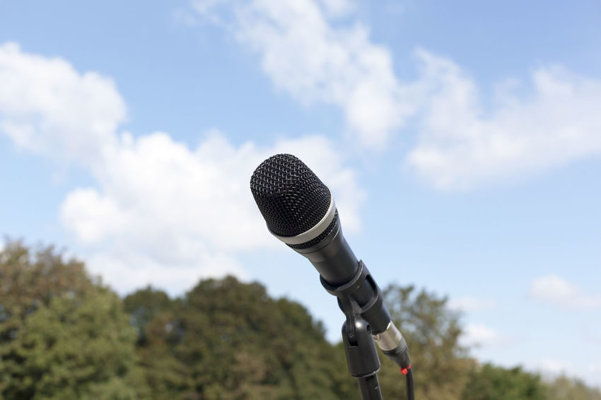 Microphone in focus against blurred background Broadcasting Broadcasting Tower Cloud - Sky Communication Day Microphone Nature No People Outdoors Press Sky Sound Technology Tv