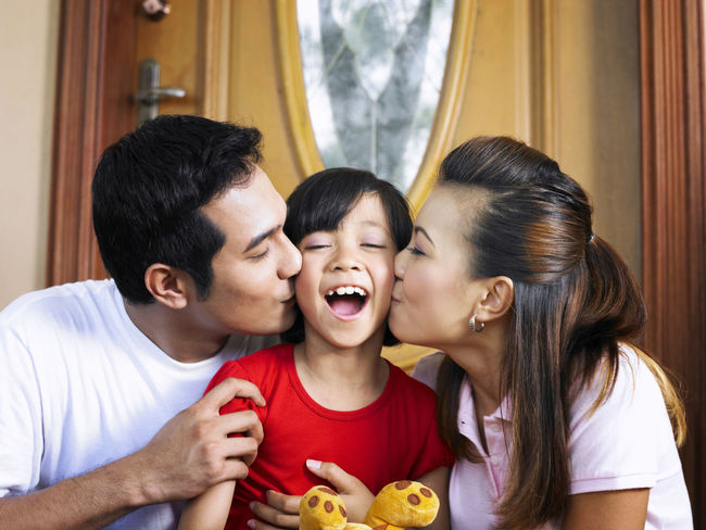 mother kissing her child Asian  Asian Family At Home Domestic Life Happiness Happy People Kiss Love Bonding Childhood Daughter Day Time Enjoy Enjoyment Eye Closed Family Father Happiness Kissing Leisure Activity Mother Parent Smiling Son Togetherness