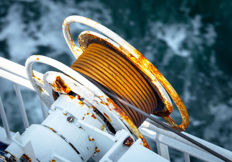 High angle view of rusty cables in boat on sea