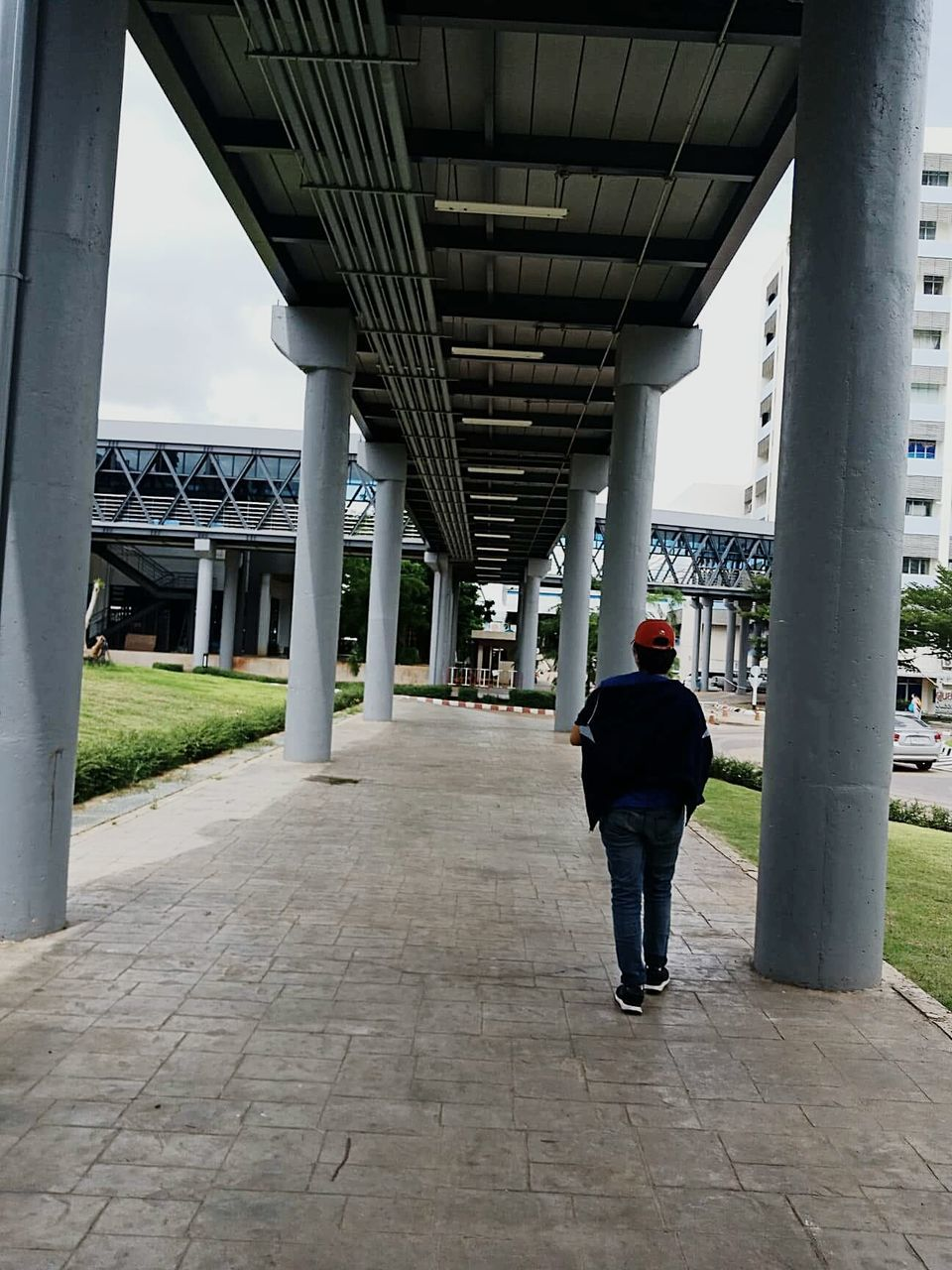 FULL LENGTH REAR VIEW OF MAN STANDING ON BRIDGE