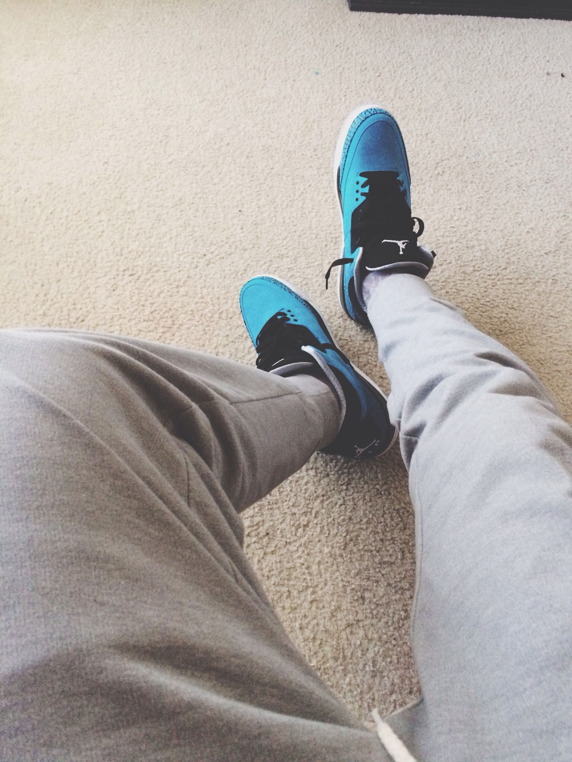 low section, person, shoe, jeans, casual clothing, lifestyles, personal perspective, men, footwear, standing, high angle view, leisure activity, relaxation, blue, sitting, human foot, indoors