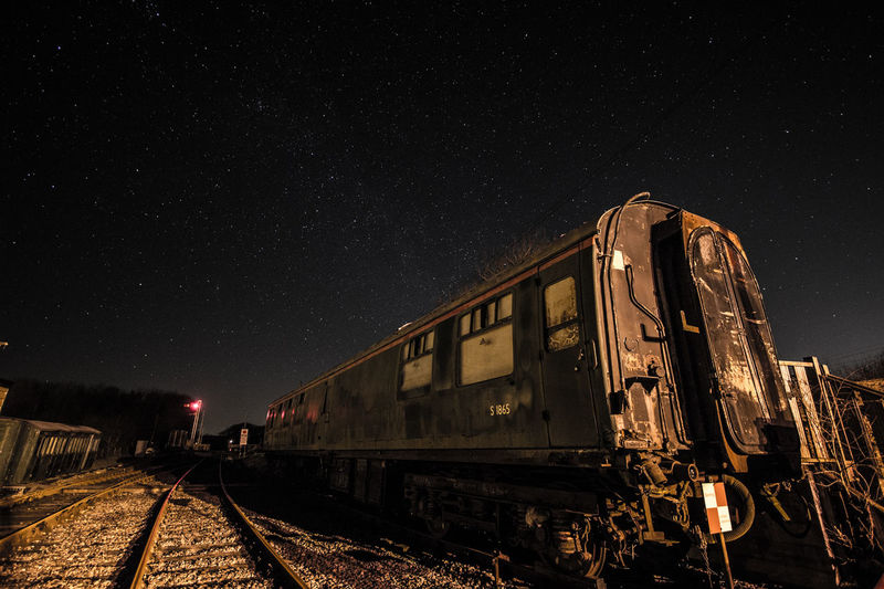 Abandoned train against night sky