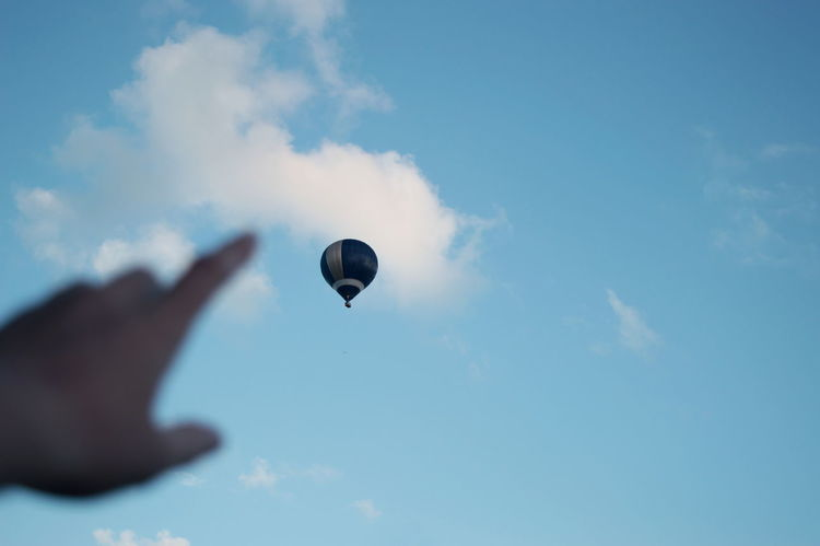 The Week On EyeEm Fresh On Eyeem  Vscocam One Person Flying Human Body Part Sky Blue Outdoors Human Hand Hot Air Balloon Up And Up EyeEm Ready   Go Higher Visual Creativity #FREIHEITBERLIN