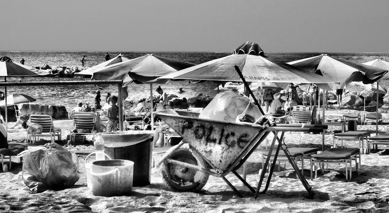 Absence Beach Beachphotography Empty Horizon Over Water In A Row Law Enforcement Parasol Place Setting Police Police Car Police Cars Police Vehicle Relaxation Sea Shore Sky Water Wheelbarrow