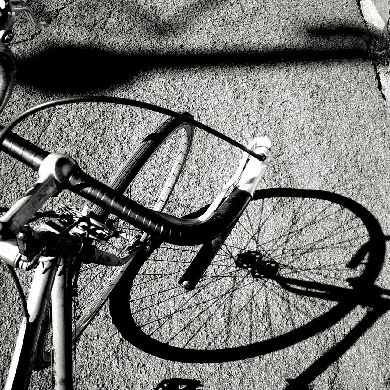 high angle view, bicycle, no people, transportation, shadow, land vehicle, outdoors, day, sunlight, bicycle rack, close-up