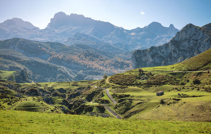 Beautiful landscape with path between mountains on a sunny day Horizontal Lake Paradise Vegetation Green Landscape Sky Blue Scenery Mountain Scenics Lakeside Ecology Natural Tree Grassland Field Valley Covadonga Asturias SPAIN Picos De Europa Beautiful Environment No People