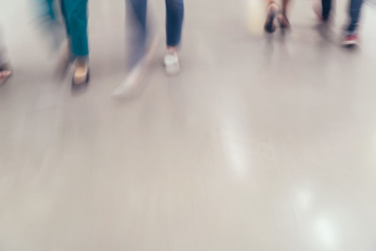 motion blur of people walking in the business office. Group Of People Blurred Motion Motion Walking Body Part Low Section Human Leg Human Body Part Defocused People Medium Group Of People Group Real People Crowd Women Men Lifestyles Unrecognizable Person Indoors  Adult Flooring Human Limb Human Foot
