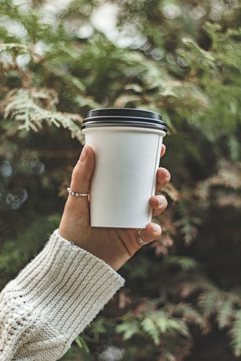 Close-up Coffee - Drink Coffee Cup Day Drink Drinking Focus On Foreground Food And Drink Freshness Holding Human Body Part Human Hand Leisure Activity Lifestyles Nature One Person Outdoors People Personal Perspective Real People Refreshment Tree Women