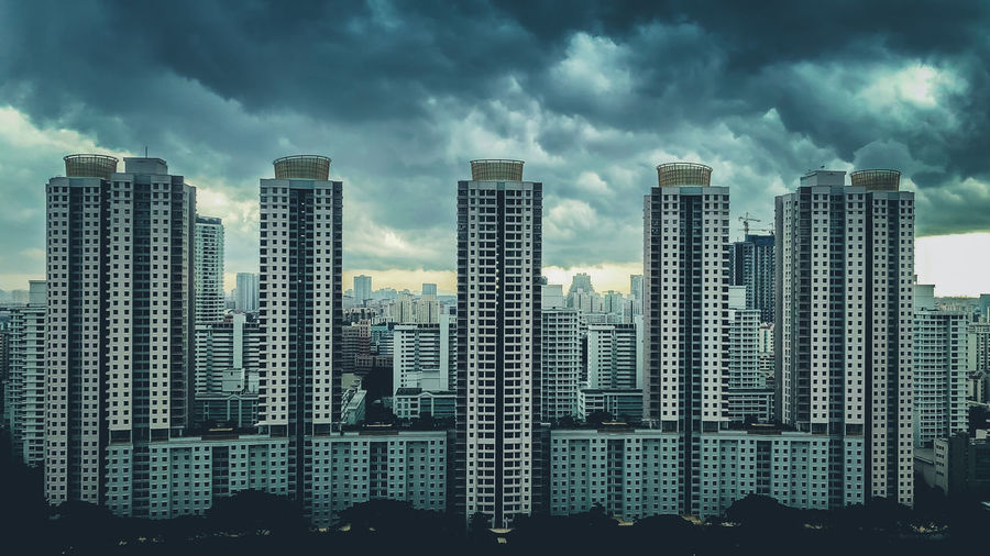 Singapore Public Housing: The Central Horizon HDB Flats Central Horizon: The Storm Approaches Public Housing HDB HDB Flats Cloud - Sky Sky Architecture Building Exterior Built Structure Building City Tall - High Residential District Urban Skyline Outdoors Cityscape No People High-rise Building Storm Clouds The Storm Approaches The Architect - 2019 EyeEm Awards