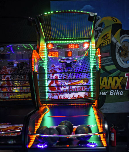 Basketball Hoop Arcade Games Illuminated Night Multi Colored Indoors  Retail  Technology Lighting Equipment No People Close-up Communication Text High Angle View Glowing Choice Arts Culture And Entertainment Variation Nightlife