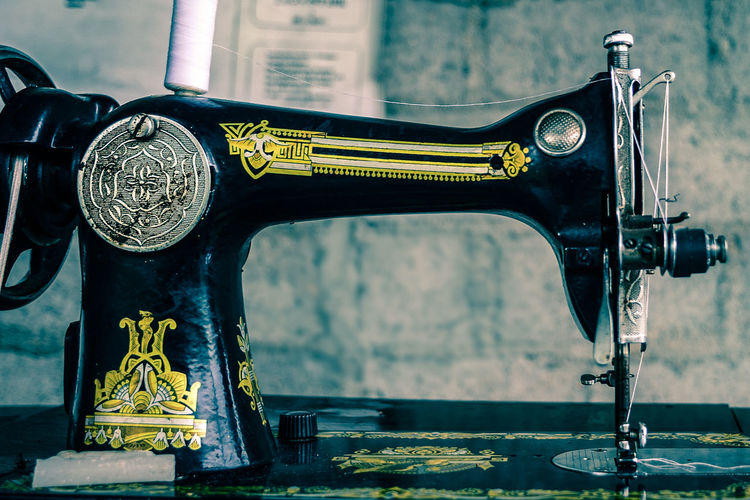 Close-Up Of Sewing Machine In Room