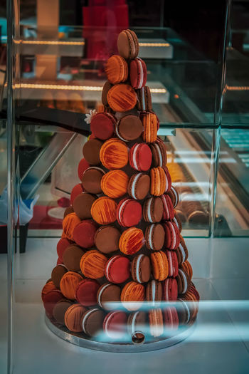 Macaroons stacked in plate for display at store