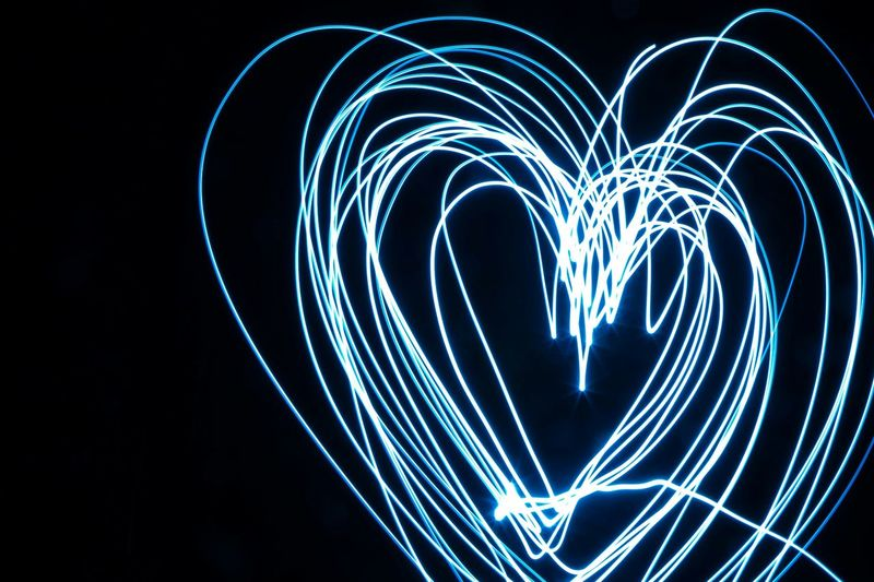Heart Shape Drawn By Light Painting At Night