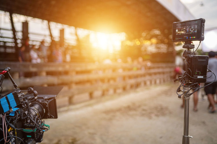 Reflection of illuminated camera on mobile phone at sunset