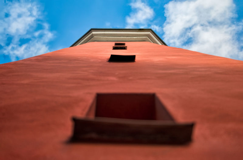 A small red tower Architecture Building Exterior Built Structure Cloud - Sky Low Angle View Outdoors Roof Sky To The Sky Tower