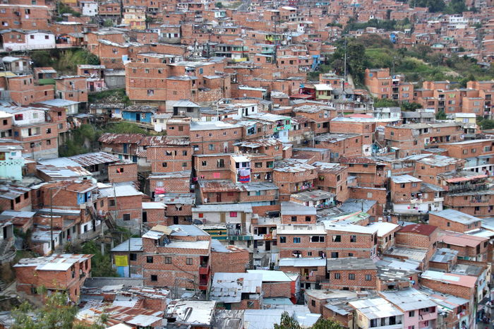 Medellín Apartment Architecture Building Building Exterior Built Structure City Cityscape Community Comuna 13 Crowd Crowded Day Full Frame High Angle View House Nature Outdoors Residential District Roof Roof Tile Settlement Shantytown Town TOWNSCAPE