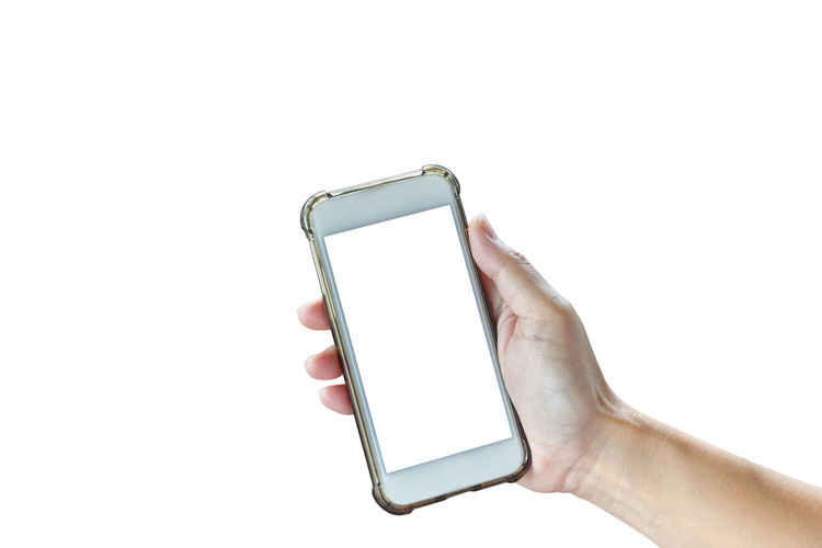 Low angle view of hand using smart phone against white background