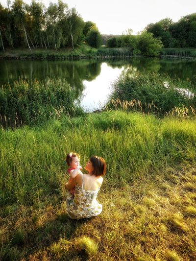 Beauties Of Ukraine Mother & Daughter My Favorite Photo EyeEm Best Shots FUJIFILM X-T1 Watching People Back To Neverland Eye4photography  EyeEm Gallery Here Belongs To Me Greenery Tree River Protecting Where We Play Forest Nature Photography Children Photography By The Lake Telling Stories Differently Ukraine Creative Light And Shadow Eyem Watiam