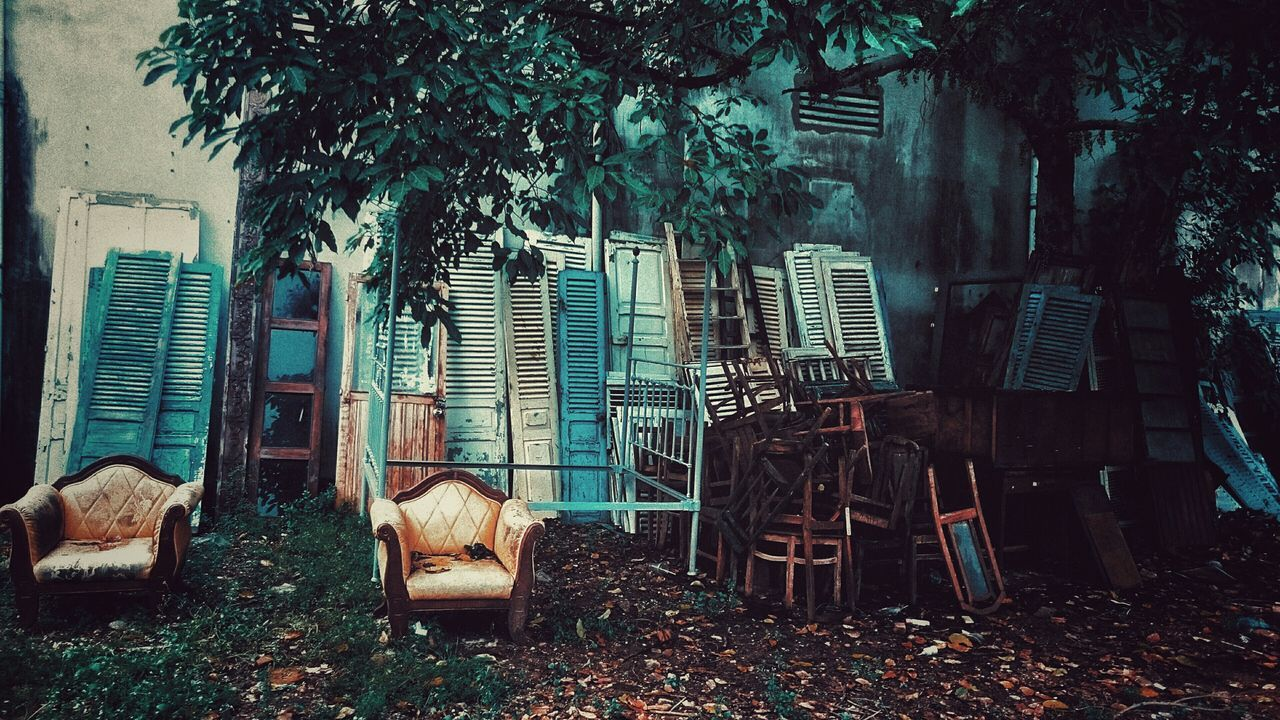 Abandoned armchairs and doors on ground