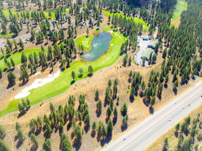 Aerial View of a mountain golf course in Truckee, California, next to I-80. Aerial View California Golf Course Interstate 80 Landscape Pine Trees Sierra Nevada Top Perspective Truckee