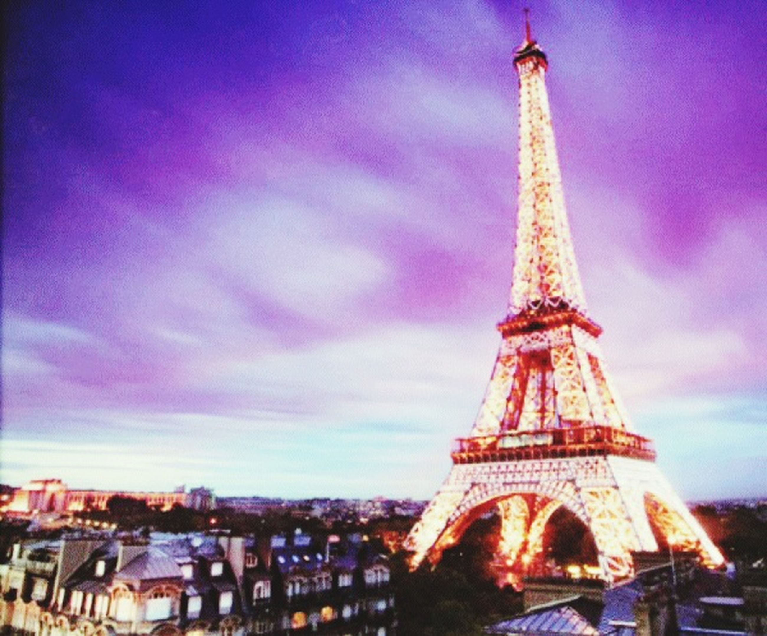 architecture, built structure, international landmark, famous place, travel destinations, capital cities, eiffel tower, tourism, tower, travel, building exterior, tall - high, city, sky, culture, low angle view, cloud - sky, spire, dusk, history