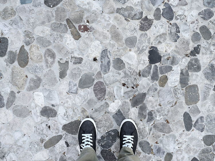 Close-Up Detail Shot of Man Shoes on Gray Pebble Background Day Footpath Footwear Gym High Angle View Human Foot Legs Lifestyles Low Section Man Shoes Outdoors Pathway Pavement Pebble Person Personal Perspective Standing Street Streetphotography
