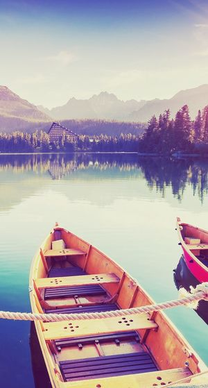 Nautical Vessel Water Moored Transportation Lake Mode Of Transport Boat Reflection Nature No People Mountain Outdoors Tranquility Beauty In Nature Scenics Rowboat Day Sky