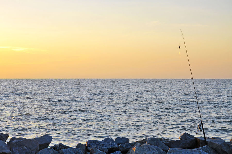 Angler Fisherman Fishing Horizon Over Water Orange Color Scenics Sea Silhouette Sky Sunset Tranquility Water