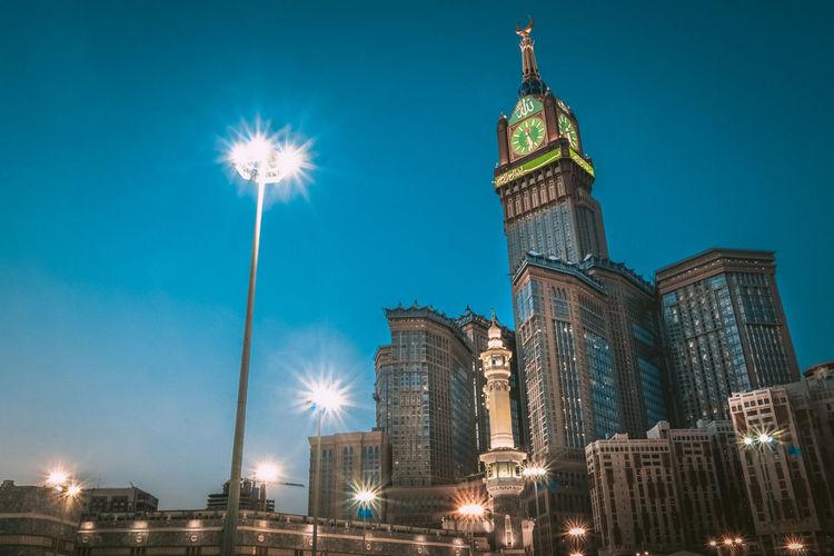 MECCA, SAUDI ARABIA - JUNE 7, 2017: Skyline with Abraj Al Bait (Royal Clock Tower Makkah) in Makkah, Saudi Arabia. The tower is the tallest clock tower in the world at 601m (1972 feet). Abraj Al Bait City Makkah Mecca Skyline Abraj Al Arabia Arch Bait Building Clock Holy Islam Landmark Saudi Tower