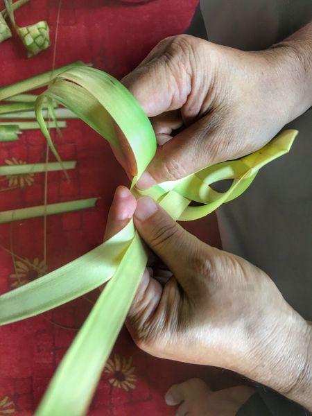 Human Hand Cutting Human Body Part Holding Leaf Indoors  One Person Close-up Real People Men Day People Anyamketupat Hari Raya Eid Mubarak EyeEmNewHere The Week On EyeEm Ketupat