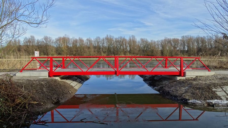 Just a red bridge... Bridge Nature Plant Day Tree Nature Plant Day Tree Sky Nature No People Architecture Blue Water Reflection