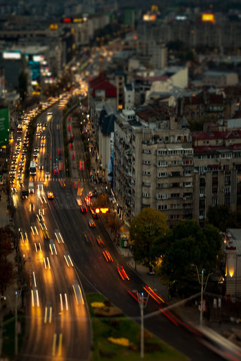 City Architecture Building Exterior Built Structure Illuminated Motion Transportation Road Light Trail Long Exposure Blurred Motion Street Night Speed Building City Life No People Traffic City Street Cityscape Outdoors Office Building Exterior Skyscraper Busy Bucharest