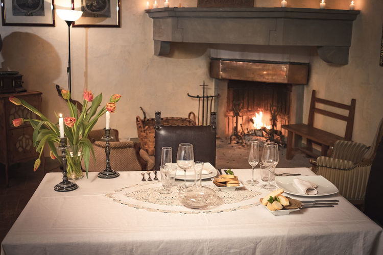 Table Food And Drink Candle Kitchen Utensil Food Plate Place Setting Seat Furniture Indoors  Flower Flowering Plant Domestic Room Household Equipment No People Tablecloth Chair Fire Home Interior Burning Setting Glass Luxury Crockery Relaxing