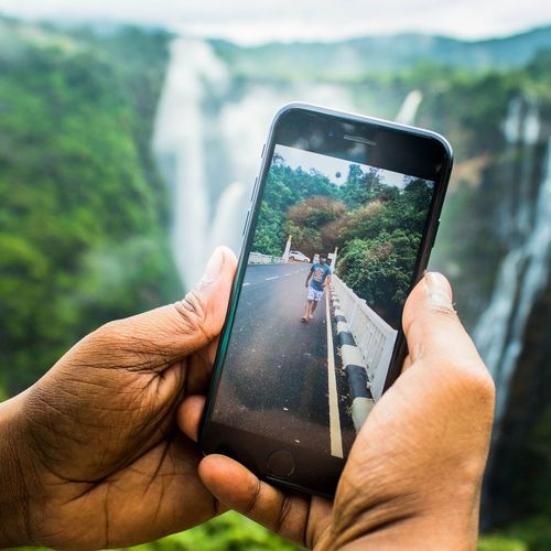 walking in falls Falls Human Hand Holding One Person Wireless Technology Smart Phone Portable Information Device