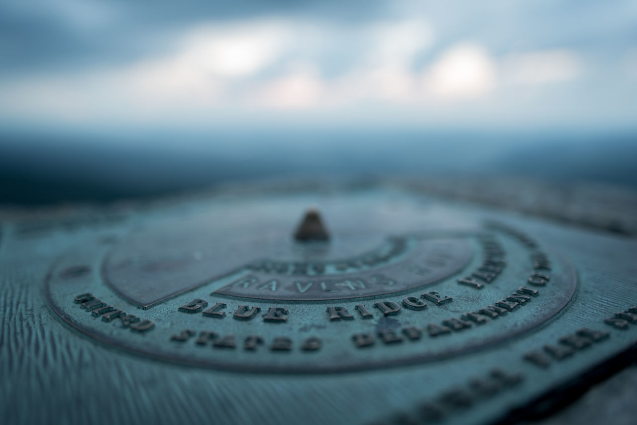 no people, number, text, selective focus, close-up, navigational compass, outdoors, day
