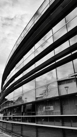 Straight stripes over curves Architecturephotography Mobile_photographer Mobilephotography #fotostrokes Samsunggalaxys9plus Streetphotography The Great Outdoors - 2018 EyeEm Awards Monochrome monochrome photography Blackandwhite Stripes Stripes Pattern The Architect - 2018 EyeEm Awards Modern Window Sky Architecture Close-up Cloud - Sky Built Structure