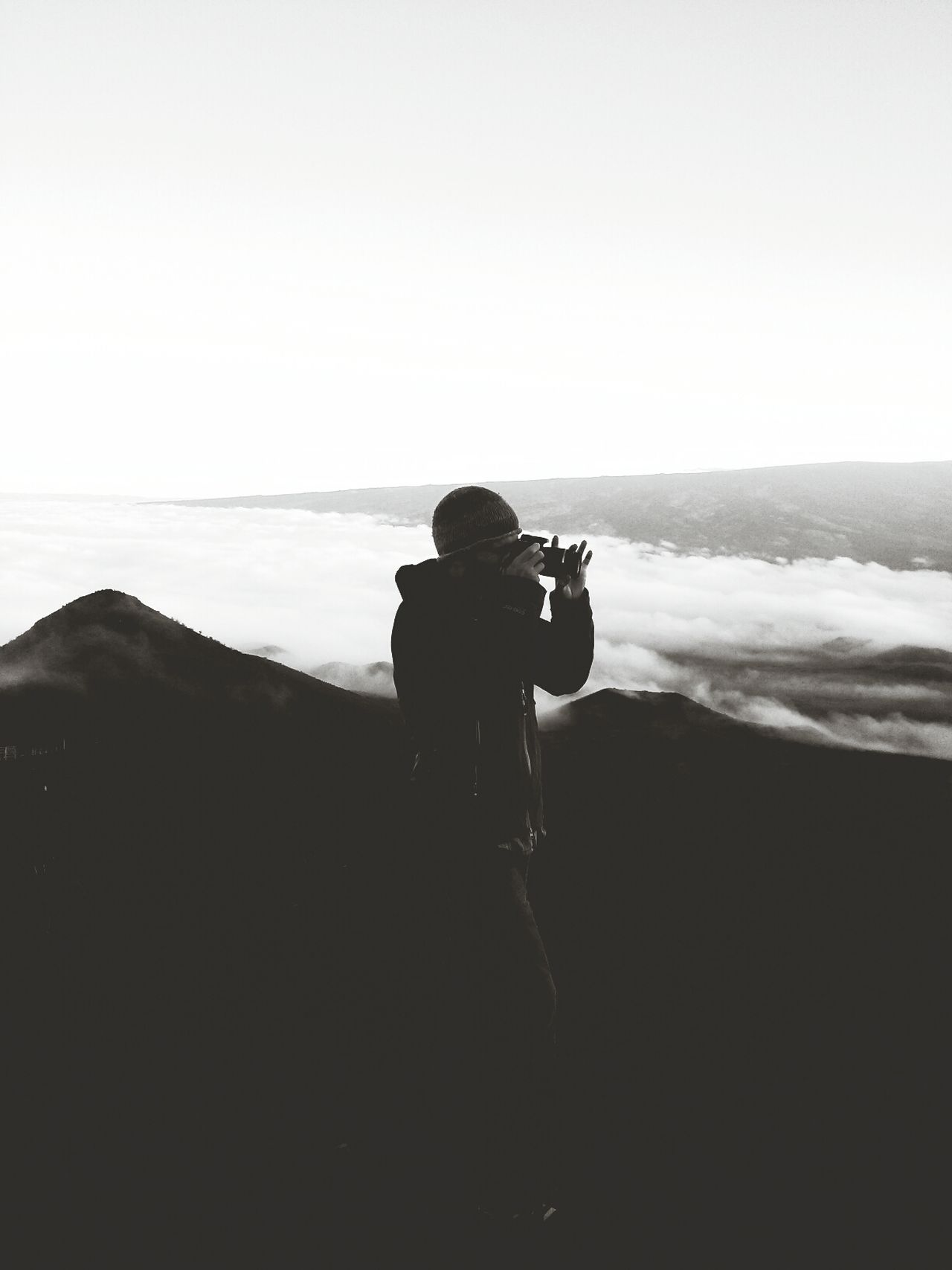 Silhouette of man photographing
