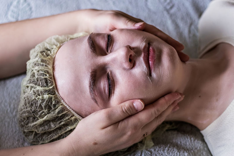 Close-up of woman getting face massage at spa