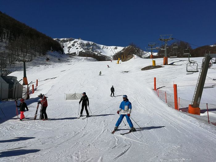 Snow Winter Cold Temperature Mountain Sport Winter Sport Skiing Real People Leisure Activity Group Of People Nature Covering Day Sky Lifestyles Men White Color Field Mountain Range Warm Clothing Ski-wear Snowcapped Mountain Outdoors Roccaraso Skiers