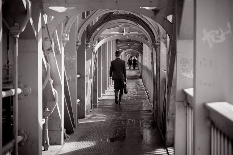 High level bridge Nikon105f4 Walking Real People The Way Forward Corridor Indoors  Arch Rear View Architecture Full Length Lifestyles Built Structure Women One Person Men Day People Adult City Life Newcastle Nikonphotography Nikon England Blackandwhite Black & White