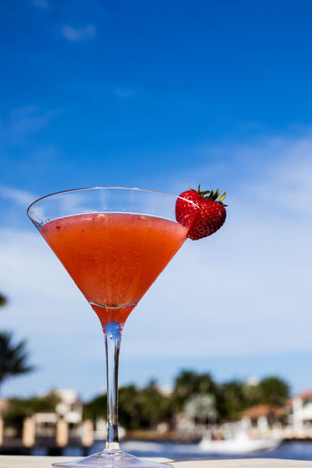 Close-up of drink against sky