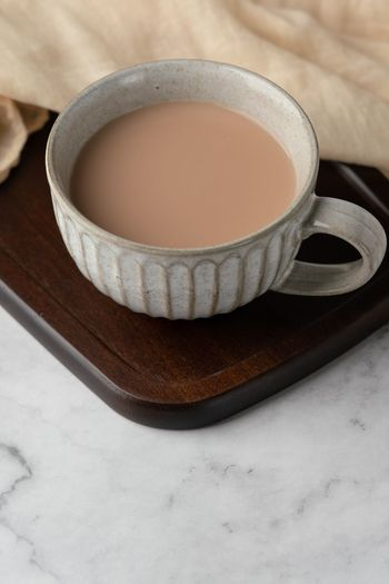 Tea With Milk Milk Tea Milky Tea Food And Drink Cup Drink Mug Hot Drink Refreshment Still Life Food Tea Indoors  Tea - Hot Drink Freshness Close-up Tea Cup High Angle View No People Wellbeing Table Ceramics Crockery